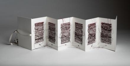 Ruff, D. (2018). Untitled (redblack1) (back).  Books series. Accordion book, thread; 6 x 20 inches.
